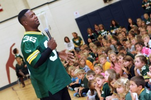 Green Bay Packer LeRoy Butler tells Big Bend Elementary students how he went from sitting in a wheelchair as a child to playing profesional football during an assembly on Oct. 13.